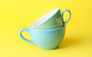 two cyan cups in yellow background