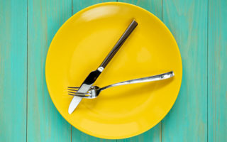 yellow plate with utensils